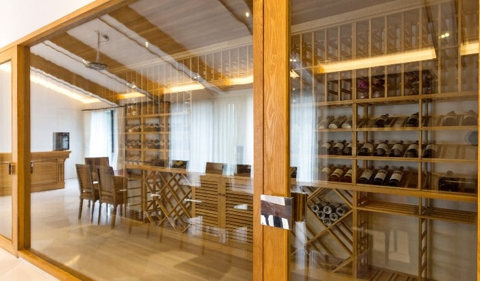 A Custom Glass-Enclosed Wine Cellar for Your Home